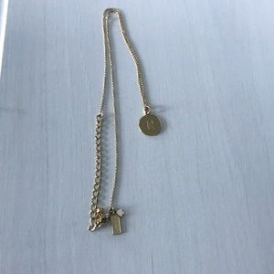 "Gold Kate spade ""R"" initial necklace"